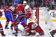 Goaltender Antti Niemi #37 of the Montreal Canadiens allows a goal by Andreas Athanasiou #72 of the Detroit Red Wings in the first period during the NHL game at the Bell Centre on October 15, 2018 in Montreal, Quebec, Canada.