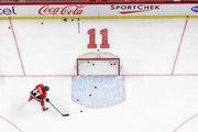 Chris Neil #25 flips a puck into the net while wearing a vintage jersey in honour of Daniel Alfredsson's jersey retirement during warm-ups prior to a game against the Detroit Red Wings at Canadian Tire Centre on December 29, 2016 in Ottawa, Ontario, Canada.  (Photo by Jana Chytilova/Freestyle Photography/Getty Images) *** Local Caption ***