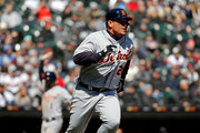 Miguel Cabrera #24 of the Detroit Tigers runs to first base after hitting a two-run RBI single against the Chicago White Sox during the third inning at Guaranteed Rate Field on April 7, 2018 in Chicago, Illinois.