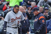 Miguel Cabrera #24 of the Detroit Tigers points to where he hurt himself after tripping and falling while running between first and second base to manager Ron Gardenhire #15 in the first inning against the Chicago White Sox during the Opening Day home game at Guaranteed Rate Field on April 5, 2018 in Chicago, Illinois.