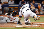 Nicholas Castellanos #9 of the Detroit Tigers scores after Wilson Ramos #40 of the Tampa Bay Rays does not have the ball when applying the tag in the seventh inning of a baseball game at Tropicana Field on July 9, 2018 in St. Petersburg, Florida.
