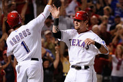 Josh Hamilton #32 and Elvis Andrus #1 of the Texas Rangers celebrate after scoring in the third inning to tie Game Six of the American League Championship Series 2-2 at Rangers Ballpark in Arlington on October 15, 2011 in Arlington, Texas.