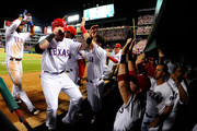 Josh Hamilton #32 and Elvis Andrus #1 of the Texas Rangers celebrate in the dugout after scoring in the third inning to tie Game Six of the American League Championship Series 2-2 at Rangers Ballpark in Arlington on October 15, 2011 in Arlington, Texas.