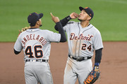 Jeimer Candelario #46 and Miguel Cabrera #24 of the Detroit Tigers celebrate a win during a baseball game against the Detroit Tigers at Oriole Park at Camden Yards on April 28, 2018 in Baltimore, Maryland.