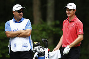 Justin Rose of England and his caddie Mark Fulcher talk on the second tee during the third round of the Deutsche Bank Championship at TPC Boston on September 1, 2013 in Norton, Massachusetts.