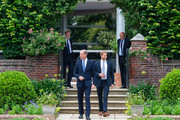 Prince William, Duke of Cambridge (left) and Prince Harry, Duke of Sussex arrive for the unveiling of a statue they commissioned of their mother Diana, Princess of Wales, in the Sunken Garden at Kensington Palace, on what would have been her 60th birthday on July 1, 2021 in London, England. Today would have been the 60th birthday of Princess Diana, who died in 1997. At a ceremony here today, her sons Prince William and Prince Harry, the Duke of Cambridge and the Duke of Sussex respectively, will unveil a statue in her memory.