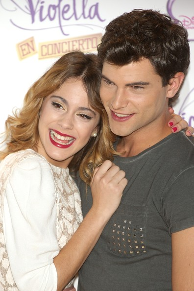 'Violetta' Madrid Photo Call [violetta,madrid photocall,hair,hairstyle,lip,interaction,smile,friendship,cheek,forehead,fun,long hair,diego dominguez,martina stoessel,madrid,spain,emperador hotel,photocall]