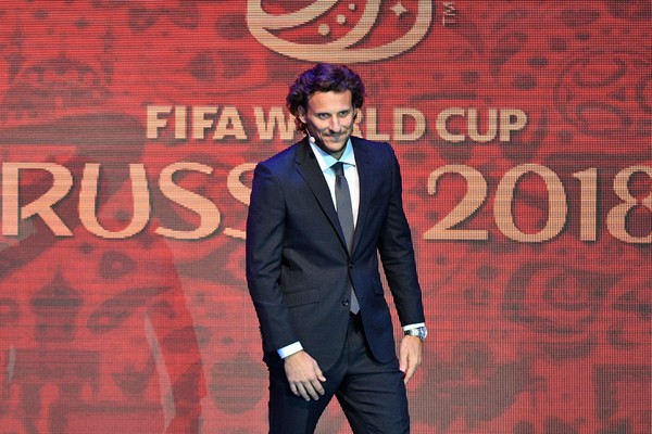 Final Draw for the 2018 FIFA World Cup Russia [red,suit,event,talent show,performance,font,formal wear,premiere,brand,diego forlan,draw,stage,russia,uruguay,state kremlin palace,moscow,cities,2018 fifa world cup,football tournament]