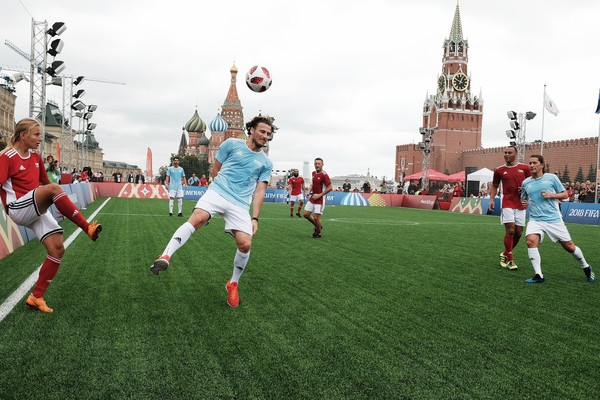 Legends Football Match - 2018 FIFA World Cup Russia [sports,team sport,ball game,football player,player,sport venue,soccer,soccer player,football,grass,marina fedorova,c,diego forlan,rest,soccer,russia,park,red square,l,legends football match - 2018 fifa world cup]
