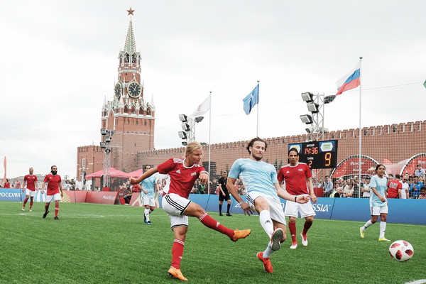 Legends Football Match - 2018 FIFA World Cup Russia [football player,sport venue,player,team sport,sports,soccer player,football,ball game,team,stadium,marina fedorova,diego forlan,soccer,rest,russia,park,red square,moscow,l,legends football match - 2018 fifa world cup]