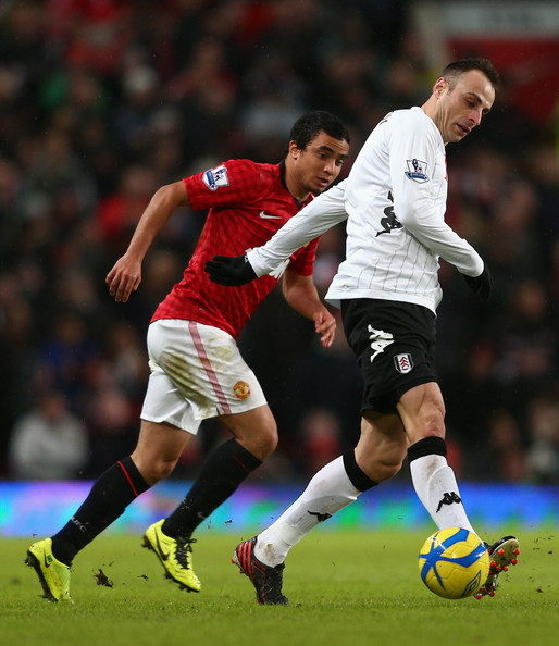 Dimitar Berbatov Dimitar Berbatov of Fulham competes with Rafael of Manchester United during the FA Cup with Budweiser Fourth Round match between Manchester United and Fulham at Old Trafford on January 26, 2013 in Manchester, England.