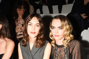 Alexa Chung and Cara Delevinge attend the Dior show as part of the Paris Fashion Week Womenswear Fall/Winter 2020/2021 on February 25, 2020 in Paris, France.