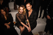 Cara Delevinge and Karlie Kloss attend the Dior show as part of the Paris Fashion Week Womenswear Fall/Winter 2020/2021 on February 25, 2020 in Paris, France.