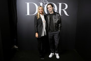 Kate Moss and Robert Pattinson attend the Dior Homme Menswear Fall/Winter 2020-2021 show as part of Paris Fashion Week on January 17, 2020 in Paris, France.