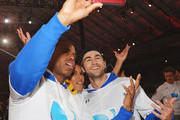(L-R) Kevin Frazier, Alicia Quarles, and Chace Crawford participate in the DirecTV Beach Bowl at Pier 40 on February 1, 2014 in New York City.