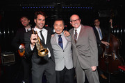Actor George Takei (C) and spouse Brad Altman (R) pose for a photo with vocalist Chris Norton during DirecTV TO BE TAKEI Media Reception at The General NYC on July 2, 2014 in New York City.