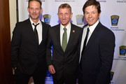 (L-R) Director Peter Berg, Boston Police Commissioner William Evans and Boston's own Mark Wahlberg attend the 3rd annual Boston Police Department Foundation Gala to present THE HERO'S AWARD to BPD Officer John Moynihan. on March 5, 2016 in Boston, Massachusetts.