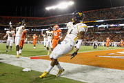 Tavon Austin #1 of the West Virginia Mountaineers reacts after he scored a 8-yard rushing touchdown in the first quarter against the Clemson Tigers during the Discover Orange Bowl at Sun Life Stadium on January 4, 2012 in Miami Gardens, Florida.