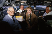 1988. (L-R) Armand Hammer, Barbara Walters in cockpit of plane.