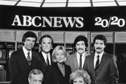 """20/20- gallery - 1/7/83.Hugh Downs and Barbara Walters anchored """"20/20"""" with correspondents, left to right: Bob Brown, Tom Jarriel, Sylvia Chase, Geraldo Rivera and John Stossel.  .(Photo by Steve Fenn/ABC via Getty Images).BOB BROWN, HUGH DOWNS, TOM JARRIEL, SYLVIA CHASE, BARBARA WALTERS, GERALDO RIVERA, JOHN STOSSEL"""