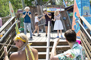 "In this handout photo provided by Disney Parks, (L-R) Actors Ross Lynch, Maia Mitchell, Garrett Clayton and Grace Phipps, from the new Disney Channel film 'Teen Beach 2,' perform during the 'Teen Beach 2:"" Beach Party at Disney's Typhoon Lagoon Water Park at Walt Disney World Resort on May 22, 2015 in Lake Buena Vista, Florida. Guests can take part in summery games, dance to retro-beach tunes and compete in hula hoop contests during the daily party that runs May 22 through July 5 as part of the 'Coolest Summer Ever' at Walt Disney World Resort."