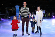 Armie Hammer and Elizabeth Chambers with children Harper and Ford attend Disney On Ice Presents Mickey's Search Party Holiday Celebrity Skating Event at Staples Center on December 13, 2019 in Los Angeles, California.