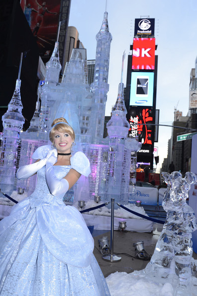 "In this handout provided by Disney Parks, Disney Princess Cinderella poses in front of a 25-foot-tall ice castle sculpture in Times Square October 17, 2012 in New York City.  Disney Parks unveiled a 25-foot-tall, 45,000-pound castle made of ice as the sun rose Oct, 17, 2012 over Times Square in New York City.  The icy structure was unveiled during the Disney Parks announcement of ""Limited Time Magic"" that will take place throughout 2013 at Disneyland Resort in California and Walt Disney World Resort in Florida.  Next year, each week at the Disney theme parks will be highlighted by a different surprise or guest enhancement for a one-week-only engagement.  Each weekly surprise, many never-before-seen in the Disney Parks, will include entertainment, dining, character experiences and more.  Each one will disappear after seven days and make way for the next week's Limited Time Magic experience.  Combined with the heat of the morning and early-afternoon sun, the ice castle in Times Square -- which took more than 12 hours to construct and craft -- demonstrates the short-lived nature of Disney's Limited Time Magic."