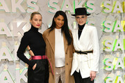 """Carolyn Murphy, Chanel Iman and Coco Rocha attend the Disney and Saks Fifth Avenue unveiling of """"Disney Frozen 2"""" windows on November 25, 2019 in New York City."""