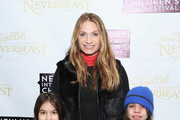 (L-R) Ella Rae Schindler, Heather Thomson and Jax Schindler attend Disneys 'Tinker Bell and the Legend of the NeverBeast' NYICFF Special Screening at SVA Theatre on February 28, 2015 in New York City.