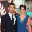 She cozies up with Theo James on the red carpet.
