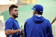Eric Hosmer #35 of the Kansas City Royals, left, talks with Salvador Perez #13 of the Kansas City Royals prior to game one of the American League Division Series between the Kansas City Royals and the Houston Astros at Kauffman Stadium on October 8, 2015 in Kansas City, Missouri.