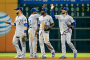 Alex Gordon #4, Alcides Escobar #2, Lorenzo Cain #6 and Paulo Orlando #16 of the Kansas City Royals celebrate after defeating the Houston Astros during game four of the American League Divison Series at Minute Maid Park on October 12, 2015 in Houston, Texas. The Royals defeated the Astros 9-6.