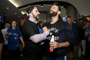 General manager Alex Anthopoulos and Jose Bautista #19 of the Toronto Blue Jays celebrate the 6-3 win against the Texas Rangers as Ben Revere #7 jumps on top of the pile in game five of the American League Division Series at Rogers Centre on October 14, 2015 in Toronto, Canada.
