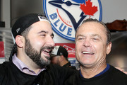 General manager Alex Anthopoulos and manager John Gibbons of the Toronto Blue Jays celebrate the 6-3 win against the Texas Rangers as Ben Revere #7 jumps on top of the pile in game five of the American League Division Series at Rogers Centre on October 14, 2015 in Toronto, Canada.