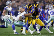 Ndamukong Suh #93 of the Los Angeles Rams tackles Ezekiel Elliott #21 of the Dallas Cowboys in the third quarter in the NFC Divisional Playoff game at Los Angeles Memorial Coliseum on January 12, 2019 in Los Angeles, California.