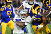 Running back Ezekiel Elliott #21 of the Dallas Cowboys is stopped by nose tackle Ndamukong Suh #93 of the Los Angeles Rams in the third quarter in the NFC Divisional Round playoff game at Los Angeles Memorial Coliseum on January 12, 2019 in Los Angeles, California.