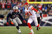 Alex Smith #11 of the Kansas City Chiefs runs with the ball against Jabaal Sheard #93 of the New England Patriots in the first half during the AFC Divisional Playoff Game at Gillette Stadium on January 16, 2016 in Foxboro, Massachusetts.