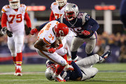 Knile Davis #34 of the Kansas City Chiefs is tackled by Dont'a Hightower #54 of the New England Patriots in the third quarter during the AFC Divisional Playoff Game at Gillette Stadium on January 16, 2016 in Foxboro, Massachusetts.