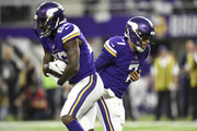 Case Keenum #7 of the Minnesota Vikings hands the ball off to Latavius Murray #25 of the NFC Divisional Playoff game against the New Orleans Saints on January 14, 2018 at U.S. Bank Stadium in Minneapolis, Minnesota.