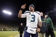 Russell Wilson #3 of the Seattle Seahawks reacts on the field after being defeated by the Green Bay Packers 28-23 in the NFC Divisional Playoff game at Lambeau Field on January 12, 2020 in Green Bay, Wisconsin.
