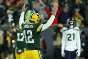 Quarterback Aaron Rodgers #12 of the Green Bay Packers celebrates a touchdown  by teammate Aaron Jones #33 against the Seattle Seahawks in the second quarter of the NFC Divisional Playoff game at Lambeau Field on January 12, 2020 in Green Bay, Wisconsin.