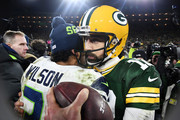 Russell Wilson #3 of the Seattle Seahawks greets Aaron Rodgers #12 of the Green Bay Packers after the Packers defeated the Seahawks 28-23 in the NFC Divisional Playoff game at Lambeau Field on January 12, 2020 in Green Bay, Wisconsin.