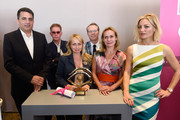 Rosalie Varda (third left) who received the Documentary Prize on behalf of her mother Agnes Varda with (L-R) Dror Moreh, Lorenzo Codelli, Thom Powers, Sandrine Bonnaire and Lucy Walker during the 70th annual Cannes Film Festival at Palais des Festivals on May 27, 2017 in Cannes, France.