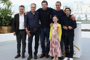 """Actors Francesco Acquaroli, Edoardo Pesce, Alida Baldari Calabria, director Matteo Garrone and actor Marcello Fonte attend the photocall for the """"Dogman"""" during the 71st annual Cannes Film Festival at Palais des Festivals on May 17, 2018 in Cannes, France."""