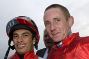 Paul Hanagan (R) is crowned champion jockey as he celebrates with nearest rival Silvestre De Sousa at Doncaster racecourse on November 05, 2011 in Doncaster, England.