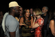 (L-R) Musician Wyclef Jean designer Donna Karan and American VOGUE Editor in Chief Anna Wintour attend the Donna Karan New York Spring 2012 fashion show during Mercedes-Benz Fashion Week at 547 West 26th Street on September 12, 2011 in New York City.