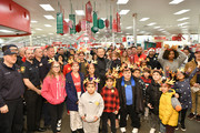 Donnie Wahlberg helps Target celebrate 10 years of its Heroes & Helpers program in Edgewater, N.J. This holiday season, Target will host nearly 400 of these events at stores nationwide, pairing first responders with kids to buy holiday gifts for their families. Since Heroes & Helpers began in 2009, Target has welcomed more than 100,000 kids and donated $5 million in grants to host these events.
