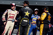 Chase Elliott (2R), driver of the #9 NAPA Auto Parts Chevrolet, talks with Brendan Gaughan (R), driver of the #62 South Point Chevrolet, Dylan Kwasniewski (2L), driver of the #31 Rockstar Chevrolet, and Ty Dillon (L), driver of the #3 Yuengling Light Lager Chevrolet, prior to the NASCAR Nationwide Series Dover 200 at Dover International Speedway on September 27, 2014 in Dover, Delaware.