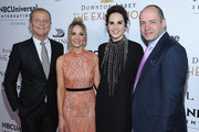 """(L-R) Kevin MacLellan, Chairman Global Distribution & International NBCUniversal, Joanne Froggatt, Michelle Dockery and Gareth Neame, Series Creator and EP and MD, Carnival Films attend the """"Downton Abbey: The Exhibition"""" Gala Receptionon November 17, 2017 in New York City."""