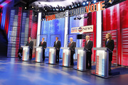 (L-R) Former Pennsylvania Sen. Rick Santorum, Texas Gov. Rick Perry, former Massachusetts Gov. Mitt Romney, former Speaker of the House Newt Gingrich, U.S. Rep. Ron Paul (R-TX), and U.S. Rep. Michele Bachmann (R-MN) stand at their podiums during the GOP debate on the campus of Drake University on December 10, 2011 in Des Moines, Iowa. Rivals were expected to target front runner Gingrich in the debate hosted by ABC News, Yahoo News, WOI-TV, The Des Moines Register and the Iowa GOP.